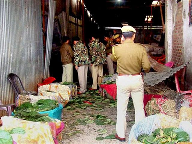 Police-officials-inspect-an-explosion-site-in-Imphal-Manipur-Security-forces-in-the-state-have-been-often-accused-of-violating-human-rights-while-fighting-militants-PTI-photo