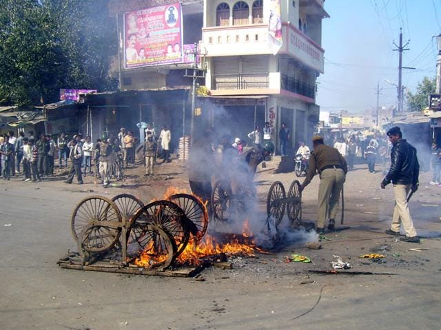 Handcarts set on fire in Gairatganj town of Raisen district after communal violence on Monday. (HT photo)