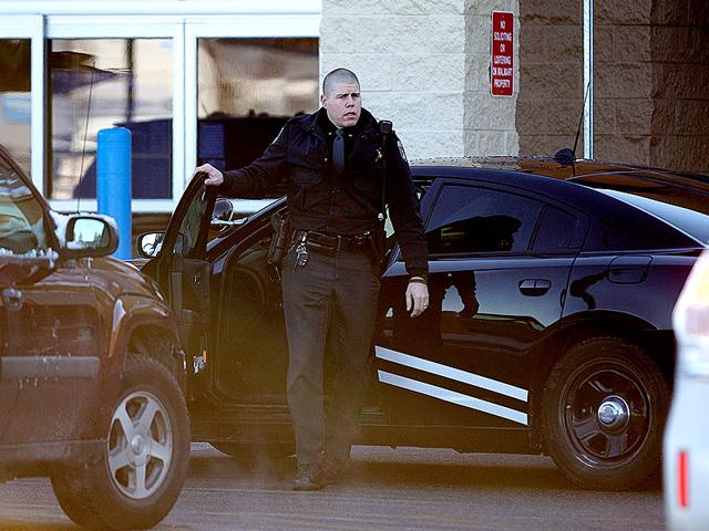 An-Idaho-State-Patrol-officer-arrives-at-Wal-Mart-in-Hayden-Idaho-where-a-2-year-old-boy-accidentally-shot-and-killed-his-mother-AP-Photo