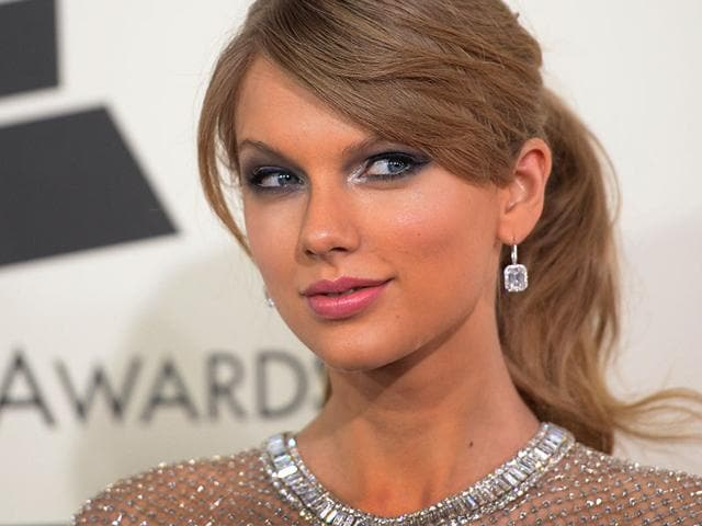 Taylor-Swift-The-singer-looked-stunning-on-the-red-carpet-of-the-56th-Grammy-Awards-ceremony-in-Los-Angeles-All-in-pastels-her-light-make-up-look-places-the-emphasis-on-her-glowing-complexion-and-plays-up-her-eyes