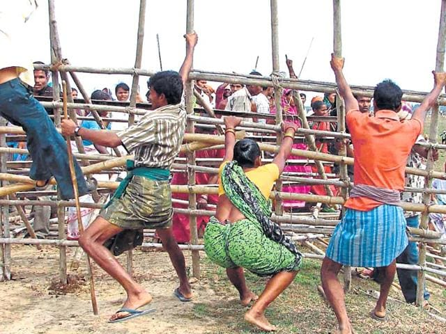 Villagers-break-barricades-protesting-against-the-Posco-steel-plant-in-Odisha-Arabinda-mahapatra-HT-file