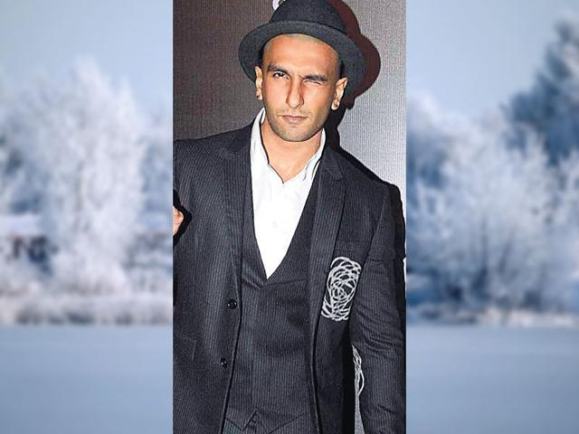 Rockstar-This-is-the-perfect-look-for-an-evening-party-Actor-Ranveer-Singh-wears-a-three-piece-black-suit-with-a-crisp-white-shirt-Always-go-for-a-contrasting-shirt-if-you-re-wearing-same-hue-suit-Add-an-edge-to-your-look-by-accessorising-with-a-hat-scarf-or-pocket-square