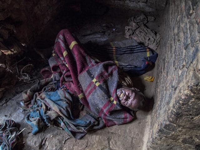 Bhola-Birhor-a-member-of-the-community-lies-paralyzed-in-his-hut-Abhishek-Saha-HT-Photo