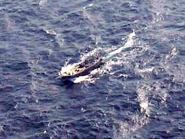 A-handout-photograph-distributed-by-the-Indian-Coast-Guard-of-the-Pakistani-boat-that-blew-itself-up-off-Porbandar-coast-ANI-Photo