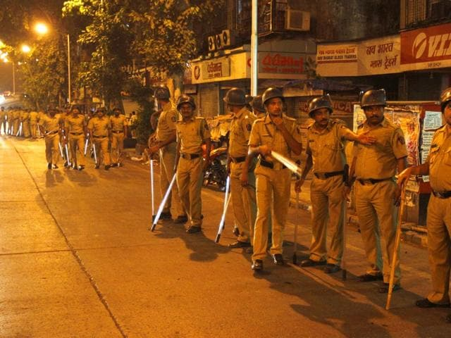 Mumbai police,Parel,rioting and unlawful assembly