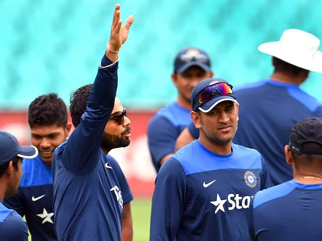 India-s-Test-captain-Virat-Kohli-speaks-to-teammates-as-former-skipper-Mahendra-Singh-Dhoni-listens-during-a-practice-session-at-the-Sydney-Cricket-Ground-SCG-ahead-of-the-fourth-Test-against-Australia-AFP-Photo
