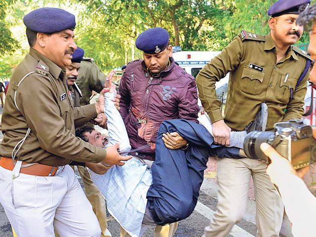 Police-carry-Manish-Goyal-who-attempted-self-immolation-in-front-of-home-minister-s-house-in-Bhopal-on-Monday-Mujeeb-Faruqui-HT-photo
