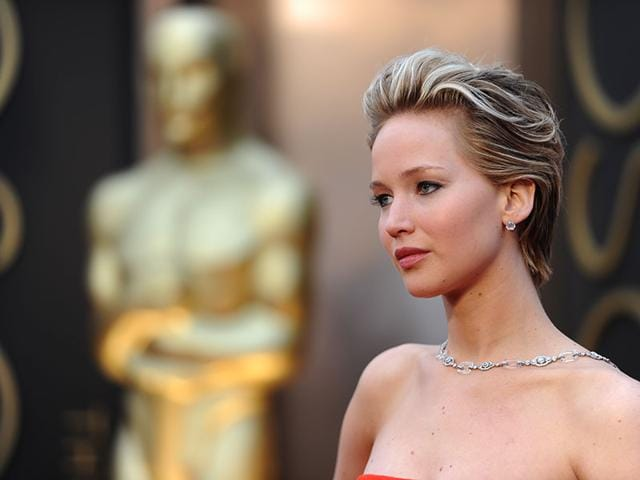Jennifer Lawrence: Formerly seen with long dark hair, for the most part, the actress transformed her look in 2014 with a short cut and rock 'n' roll blonde highlights. Here, she poses on the red carpet at the 86th Oscars ceremony in Hollywood.