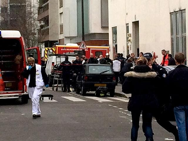 A-victim-is-evacuated-on-a-stretcher-after-armed-gunmen-stormed-the-offices-of-the-French-satirical-newspaper-Charlie-Hebdo-in-Paris-leaving-at-least-11-people-dead--AFP-photo