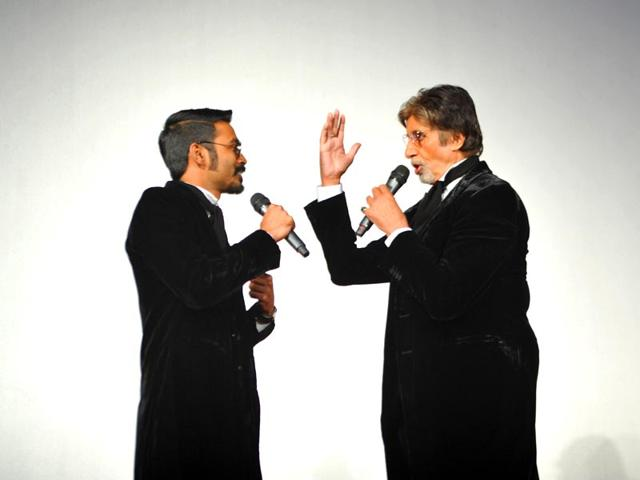 Dhanush and Amitabh Bachchan sharing a light moment.