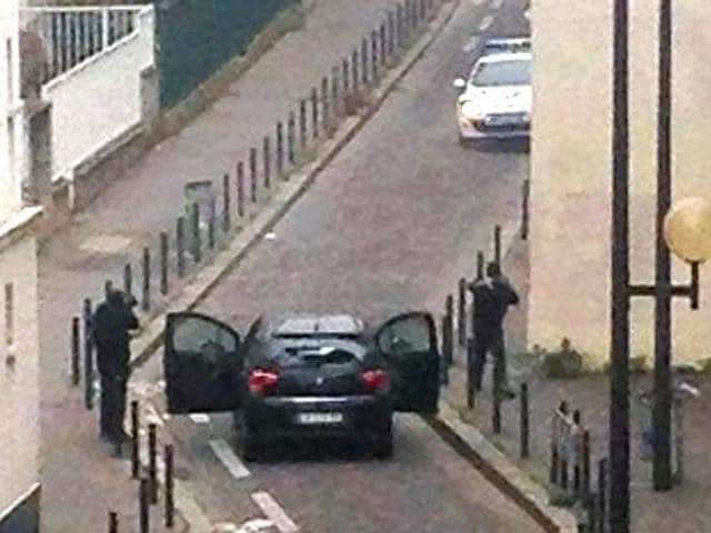 Armed-gunmen-face-police-officers-near-the-offices-of-the-French-satirical-newspaper-Charlie-Hebdo-in-Paris-on-Wednesday-AFP-Photo