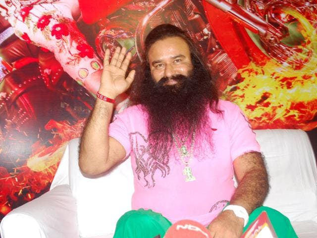Gurmeet-Ram-Rahim-Singh-posing-with-the-poster-of-his-film-MSG