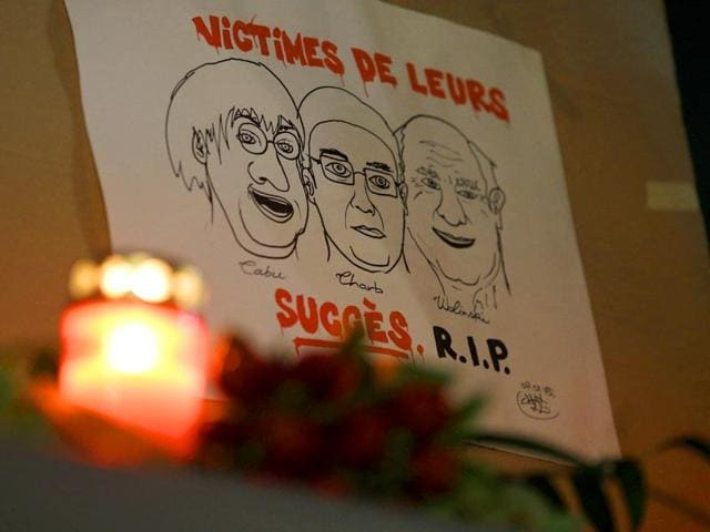 A-drawing-depicting-cartoonist-Jean-Cabut-left-Charlie-Hebdo-editor-Stephane-Charbonnier-centre-and-cartoonist-Georges-Wolinski-and-reading-in-French-Victims-of-their-success-R-I-P-outside-the-French-Embassy-in-Berlin-AP-Photo