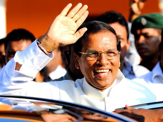 Sri-Lanka-s-main-opposition-presidential-candidate-Maithripala-Sirisena-gestures-as-he-leaves-after-casting-his-vote-during-the-presidential-elections-at-a-polling-station-in-Polonnaruwa-AFP-photo