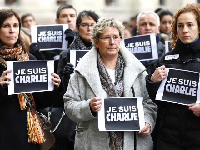 A-candle-burns-on-a-sign-that-reads-in-French-I-am-Charlie-during-a-gathering-in-solidarity-with-those-killed-in-an-attack-at-the-Paris-offices-of-the-weekly-newspaper-Charlie-Hebdo-in-Sao-Paulo-Brazil-AP-Photo