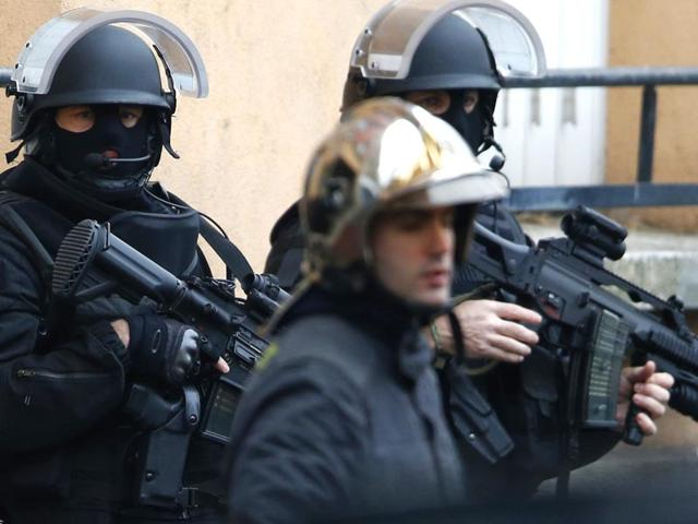 Armed-French-intervention-police-and-firemen-gather-at-the-scene-of-a-shooting-in-the-street-of-Montrouge-near-Paris-AFP-photo
