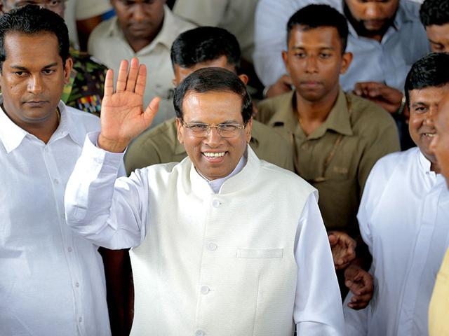 Sri-Lanka-s-President-Maithripala-Sirisena-waves-to-supporters-as-he-leaves-the-election-secretariat-in-Colombo-Sri-Lanka-AP-File-Photo