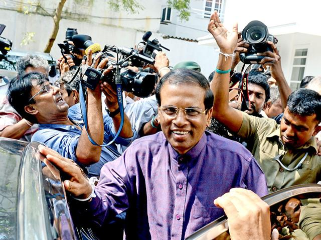 Sri-Lanka-s-newly-elected-president-Maithripala-Sirisena-leaves-the-opposition-leader-s-office-after-meeting-with-political-leaders-who-supported-him-in-the-capital-Colombo-AFP-Photo