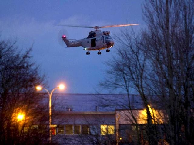 A-helicopter-flies-over-a-building-where-the-suspects-of-a-shooting-at-a-Paris-newspaper-office-were-holed-up-in-Dammartin-en-Goele-France-AP-photo