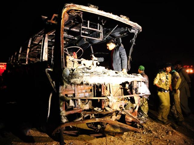 Volunteers-search-for-victims-inside-a-burnt-out-passenger-bus-after-it-collided-with-an-oil-tanker-along-the-Super-Highway-near-Karachi-AFP-Photo