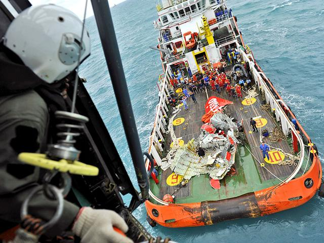 Portion-of-the-tail-of-AirAsia-Flight-8501-is-seen-on-the-deck-of-a-rescue-ship-after-it-was-recovered-from-the-sea-floor-on-the-Java-Sea-AP-Photo
