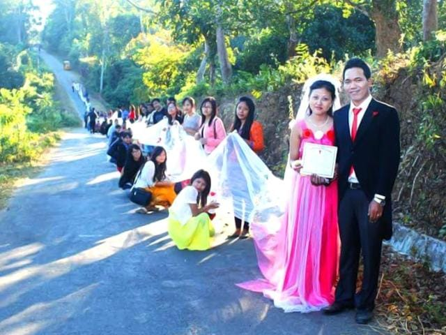 Kanika-Debbarma-wore-a-pink-gown-with-a-train-as-long-as-110-metres-said-to-be-longest-worn-by-a-bride-in-India-HT-Photo