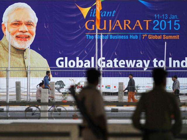 Workers-erect-an-electric-pole-near-the-venue-of-Vibrant-Gujarat-Summit-2015-in-Gandhinagar-PM-Modi-promised-the-summit-India-will-become-the-easiest-place-to-do-business-AP-Photo