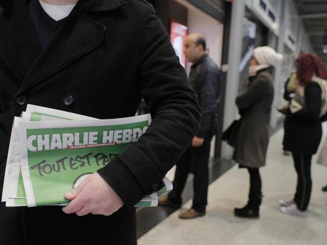 A-man-leaves-after-buying-Charlie-Hebdo-newspapers