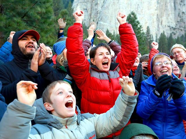 Gaelena-Jorgenson-of-Santa-Rosa-centre-in-red-raises-her-arms-as-her-son-Kevin-completes-a-free-climb-of-El-Capitan-in-the-Yosemite-Valley-on-Wednesday-AP-Photo