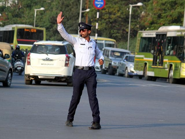 Sumant-Singh-Kachhawa-controls-traffic-at-White-Church-Road-junction-in-Indore-on-Thursday-Shankar-Mourya-HT-photo
