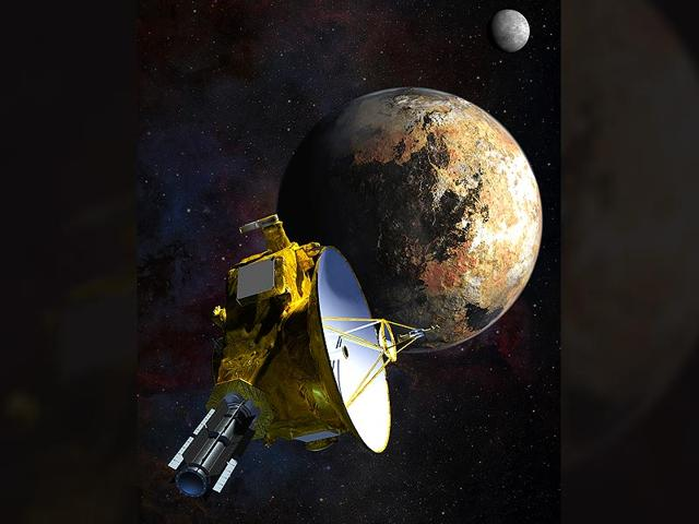Artist-s-concept-of-NASA-s-New-Horizons-spacecraft-as-it-passes-Pluto-and-Pluto-s-largest-moon-Charon-Photo-NASA-JHU-APL-SwRI-Steve-Gribben