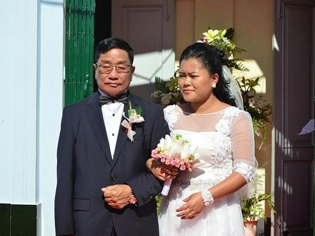 Manipur-minister-Phungzathang-Tonsing-77-with-his-24-year-old-bride-Thangngaihsang-HT-photo