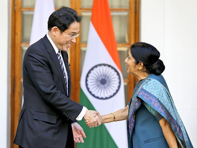 Japanese-foreign-minister-Fumio-Kishida-shakes-hand-with-Indian-foreign-minister-Sushma-Swaraj-AP-File-Photo