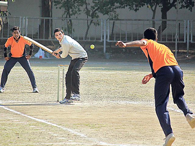 The-cricket-match-between-two-police-teams-during-a-departmental-tournament-organised-to-build-bridges-between-officers-and-the-ranks-in-Indore-on-Saturday-Shankar-Mourya-HT-photo