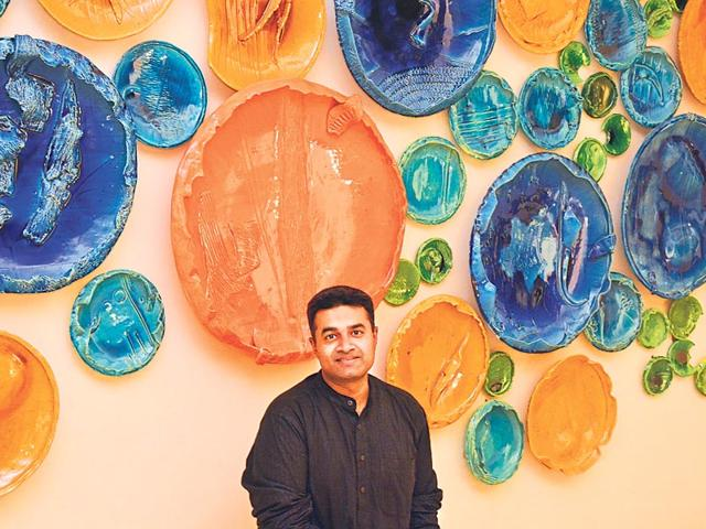 Artist-Rahul-Kumar-poses-with-Circle-Uncircled-an-installation-that-will-be-on-display-at-the-India-Art-Fair-in-Delhi-HT-Photo