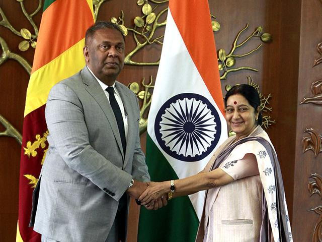 External-Affairs-Minister-Sushma-Swaraj-R-shake-hands-with-Sri-Lankan-Foreign-Minister-Mangala-Samaraweera-L-in-New-Delhi-on-Sunday--Sanjeev-Verma-HT-Photo