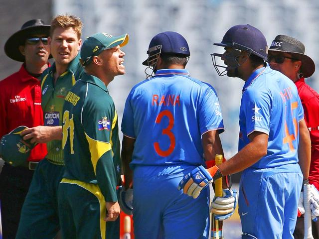 David-Warner-argues-with-Rohit-Sharma-as-Suresh-Raina-tries-to-intervene-during-their-ODI-tri-series-match-at-the-Melbourne-Cricket-Ground-in-Melbourne-Reuters-Photo