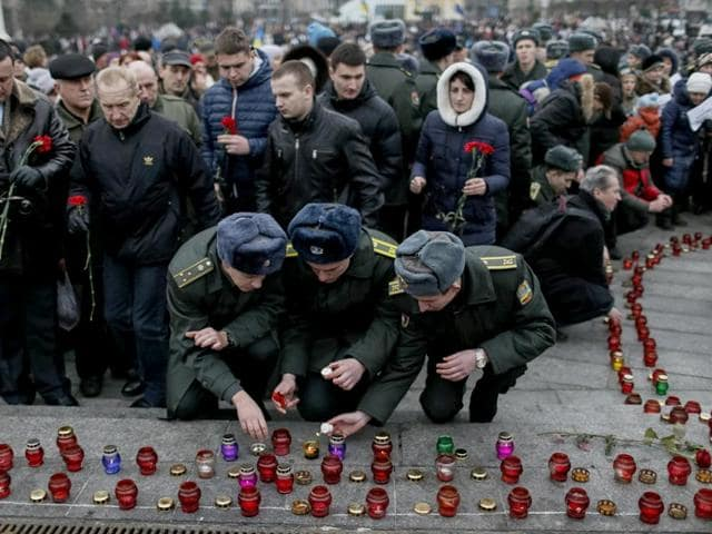 Military-cadets-light-candles-during-a-peace-march-in-Kiev-on-January-18-2015-for-the-victims-on-a-passenger-bus-which-came-under-fire-near-the-town-of-Volnovakha-in-eastern-Ukraine-The-bus-came-under-heavy-fire-on-January-13-killing-at-least-10-people-Ukrainian-authorities-said-and-fighting-intensified-around-the-international-airport-in-the-city-of-Donetsk-as-separatists-tried-to-oust-government-forces-Reuters
