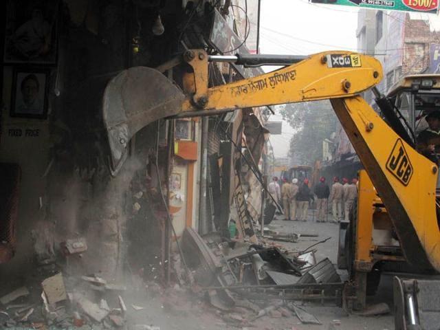 A-JCB-machine-demolishing-encroachments-during-an-anti-encroachment-drive-in-the-city-JS-Grewal-HT