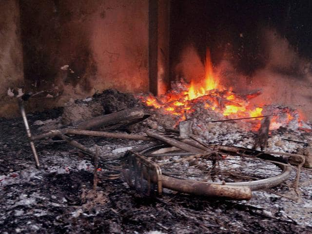 A-cycle-and-a-house-set-on-fire-during-violence-in-a-village-in-Muzaffarpur-in-Bihar-PTI-Photo
