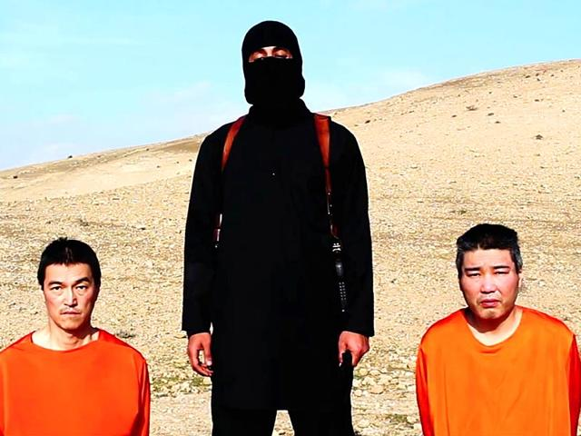 This-image-taken-from-an-online-video-released-by-the-Islamic-State-group-s-al-Furqan-media-arm-on-Tuesday-purports-to-show-the-group-threatening-to-kill-two-Japanese-hostages-that-the-militants-identify-as-Kenji--Goto-Jogo-left-and-Haruna-Yukawa-right-unless-a-200-million-ransom-is-paid-within-72-hours-AP-Photo