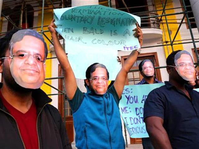 Employees-of-various-IT-IT-enabled-services-companies-wear-masks-of-Tata-Consultancy-Services-TCS-chief-executive-officer-Natarajan-Chandrasekaran-during-a-protest-in-Bangalore-AP-photo