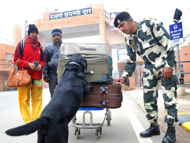Indian-Border-Security-Force-BSF-member-uses-a-sniffer-dog-to-check-the-luggage-of-Pakistani-nationals-as-they-cross-the-India-Pakistan-border-at-Wagah-about-35-kms-from-Amritsar-AFP-photo