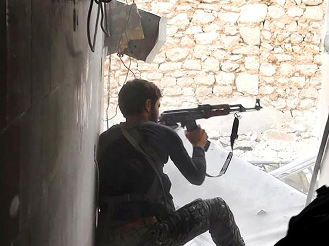 This-undated-file-photo-posted-by-the-Raqqa-Media-Office-of-the-Islamic-State-group-shows-an-IS-group-fighter-in-Kobani-Syria-AP-Photo