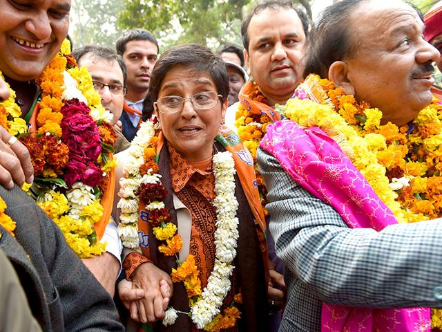 Kiran-Bedi-C-gestures-during-a-road-show-while-heading-to-the-district-collectors-office-to-file-her-nomination-papers-in-New-Delhi-on-Wednesday-AFP-Photo