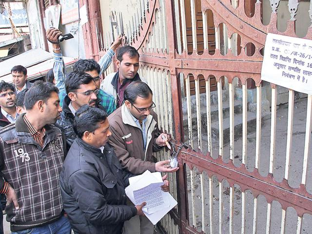 District-officials-seal-the-property-of-Rajwada-in-Dhar-on-Tuesday-HT-photo