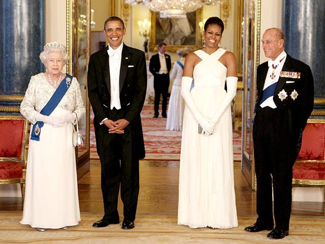 The US First Couple attend a state banquet hosted by Queen Elizabeth on May 24, 2011 at Buckingham Palace, London. Michelle wore a white Tom Ford gown with matching gloves.