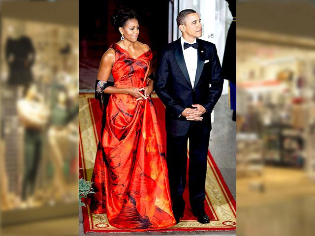 Mrs Obama joins the US President at the White House State Dinner in 2011, in a vibrant Alexander McQueen gown.