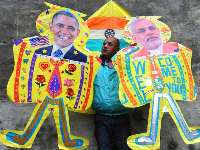 A-kitemaker-poses-with-kites-adorned-with-images-of-US-President-Barack-Obama-and-Prime-Minister-Narendra-Modi-in-Amritsar-AFP-photo