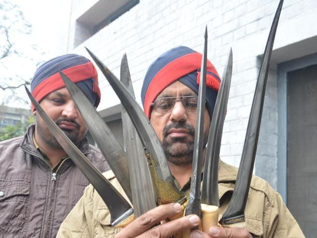 Policemen-showing-the-daggers-recovered-in-Amritsar-on-Wednesday-Sameer-Sehgal-HT